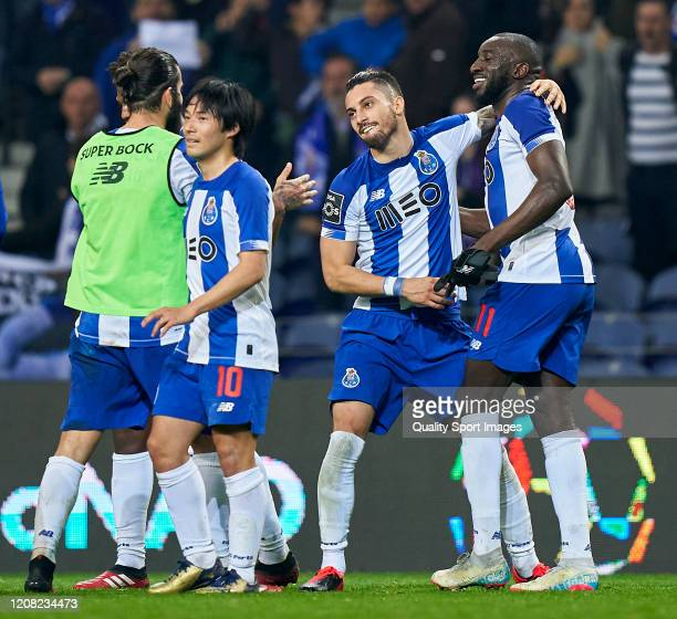 Alex Telles and Moussa Marega of FC Porto celebrate the victory at the end of the Liga Nos match between FC Porto and Portimonense SC at Estadio do...