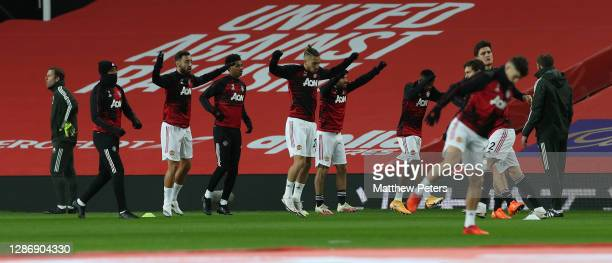 Alex Telles Fred Harry Maguire Juan Mata Victor Lindelof Aaron WanBissaka Nemanja Matic of Manchester United warm up ahead of the Premier League...