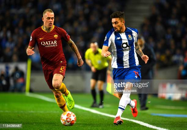 Alex Telles of FC Porto and of AS Roma clash during the UEFA Champions League Round of 16 Second Leg match between FC Porto and AS Roma at Estadio do...