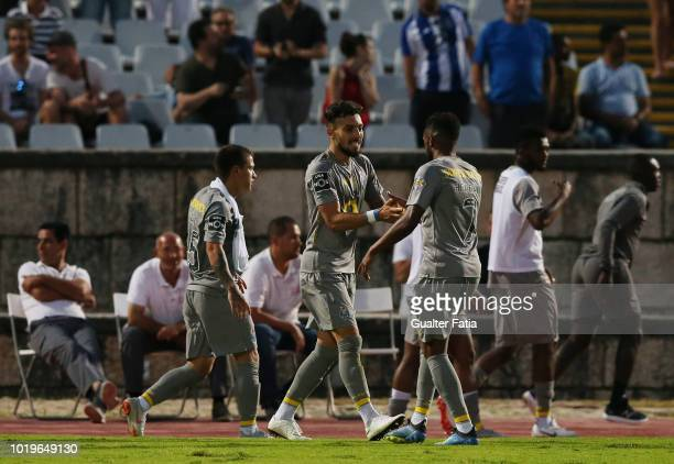 Alex Telles of FC Porto celebrates after scoring a goal during the Liga NOS match between CF Os Belenenses and FC Porto at Estadio Nacional on August...