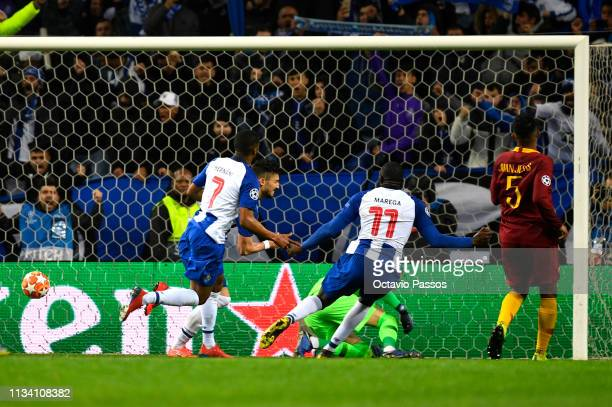 Alex Telles of FC Porto celebrates after scoring his sides third goal during the UEFA Champions League Round of 16 Second Leg match between FC Porto...