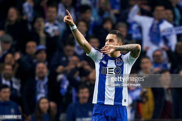 Alex Telles of FC Porto celebrates after scoring his team's second goal during the Liga Nos match between FC Porto and SL Benfica at Estadio do...