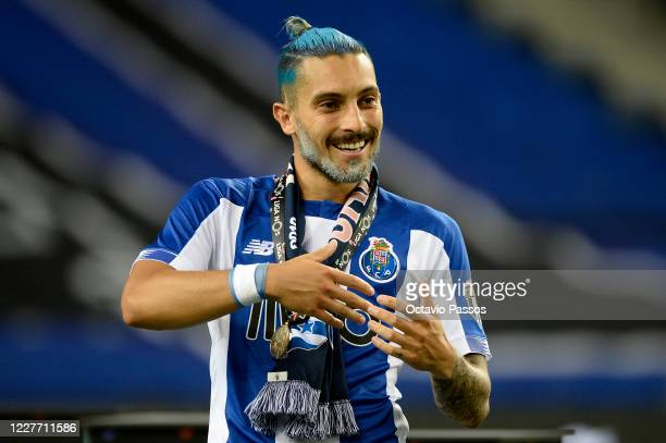 Alex Telles of FC Porto celebrates after winning the league title following the Liga Nos match between FC Porto and Moreirense FC at Estadio do...