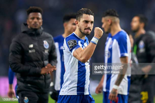 Alex Telles of FC Porto celebrates the victory at the end of during the Liga Nos match between FC Porto and SL Benfica at Estadio do Dragao on...