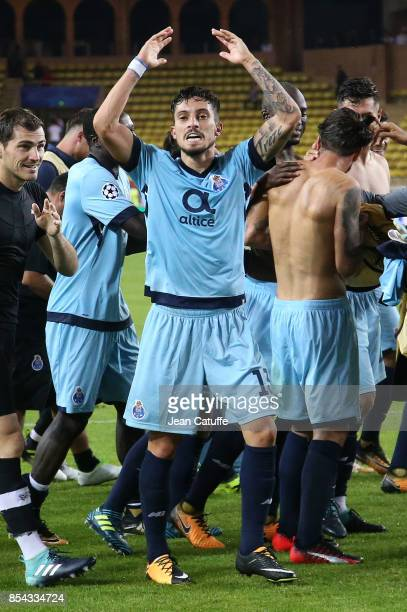 Alex Telles of FC Porto celebrates the victory following the UEFA Champions League group G match between AS Monaco and FC Porto at Stade Louis II on...
