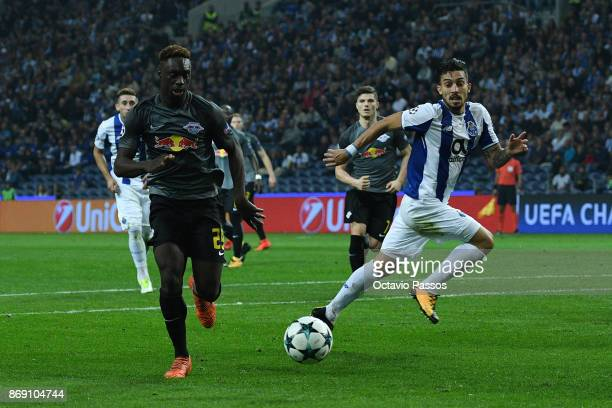 Alex Telles of FC Porto competes for the ball with JeanKevin Augustin of RB Leipzig during the UEFA Champions League group G match between FC Porto...