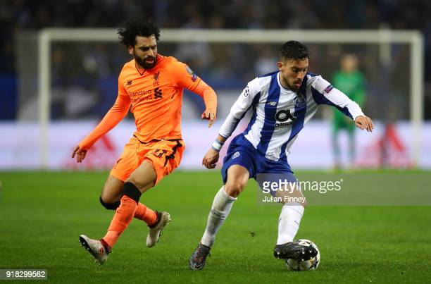 Alex Telles of FC Porto holds off Mohamed Salah of Liverpool during the UEFA Champions League Round of 16 First Leg match between FC Porto and...