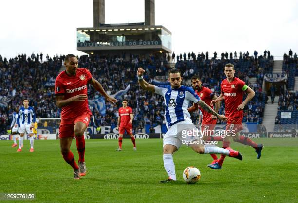 Alex Telles of FC Porto is closed down by Jonathan Tah of Bayer Leverkusen during the UEFA Europa League round of 32 second leg match between FC...
