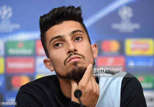 Alex Telles of FC Porto looks on during a FC Porto Training Sesion and Press Conference ahead of their Champions League match against Leicester City...