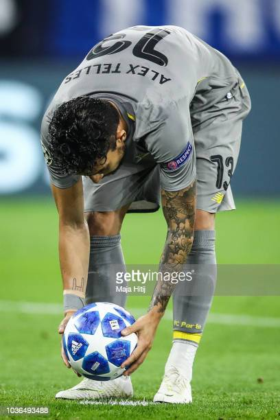Alex Telles of FC Porto places the ball during the Group D match of the UEFA Champions League between FC Schalke 04 and FC Porto at VeltinsArena on...