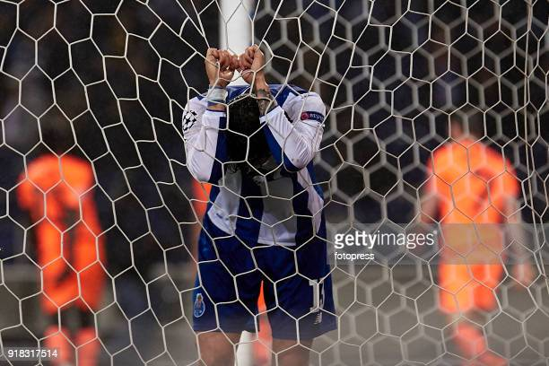 Alex Telles of FC Porto reacts after Roberto Firmino of Liverpool FC scored his team's fourth goal during the UEFA Champions League Round of 16 First...