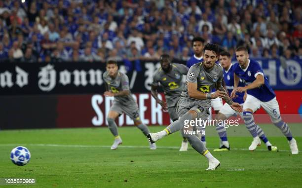 Alex Telles of FC Porto takes a penalty and misses during the Group D match of the UEFA Champions League between FC Schalke 04 and FC Porto at...