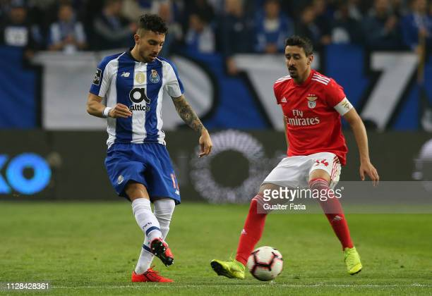 Alex Telles of FC Porto with Andre Almeida of SL Benfica in action during the Liga NOS match between FC Porto and SL Benfica at Estadio do Dragao on...