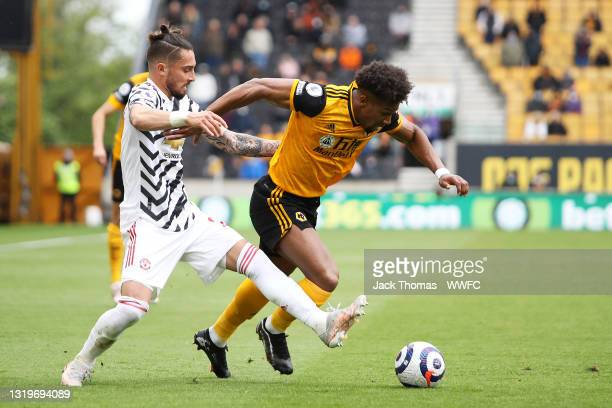 Alex Telles of Manchester United battles for possession with Adama Traore of Wolverhampton Wanderers during the Premier League match between...