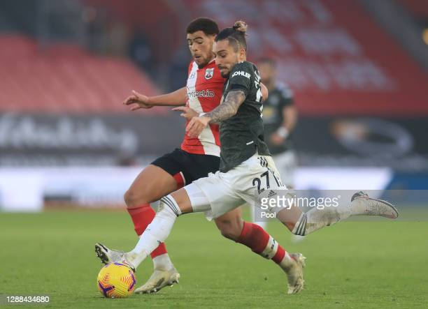 Alex Telles of Manchester United battles for possession with Che Adams of Southampton during the Premier League match between Southampton and...