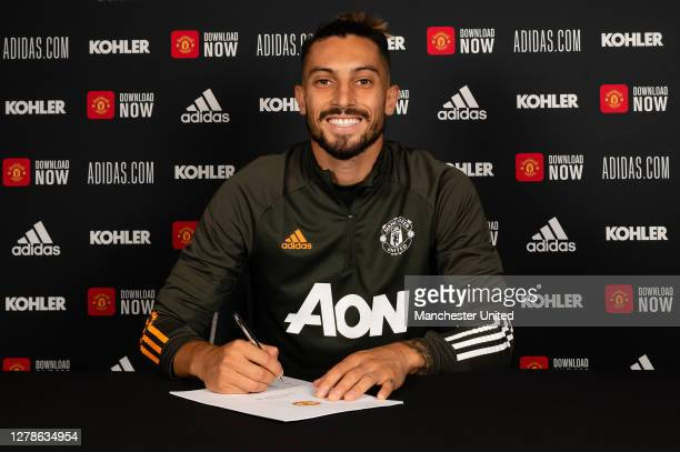 Alex Telles of Manchester United poses after signing for the club at Aon Training Complex on October 05 2020 in Manchester England