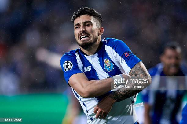 Alex Telles of Porto celebrates after scoring his team's third goal during the UEFA Champions League Round of 16 Second Leg match between FC Porto...