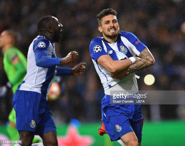 Alex Telles of Porto celebrates scoring the winning penalty in extra time during the UEFA Champions League Round of 16 Second Leg match between FC...