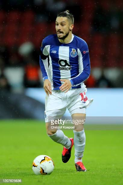 Alex Telles of Porto runs with the ball during the UEFA Europa League Round of 32 first leg match between Bayer 04 Leverkusen and FC Porto at...