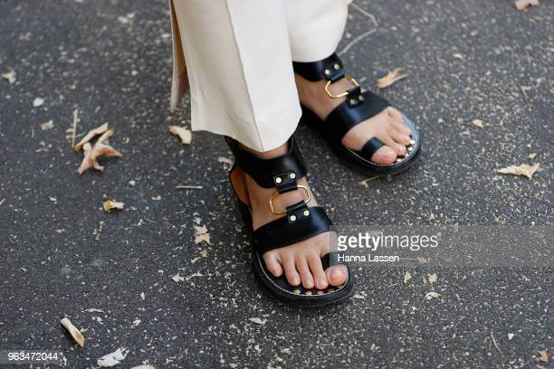 Alex Teo shoe detail wearing Khaite pants and jacket Shaina Mote sweater and Isabel Marant sandals on May 29 2018 in Sydney Australia