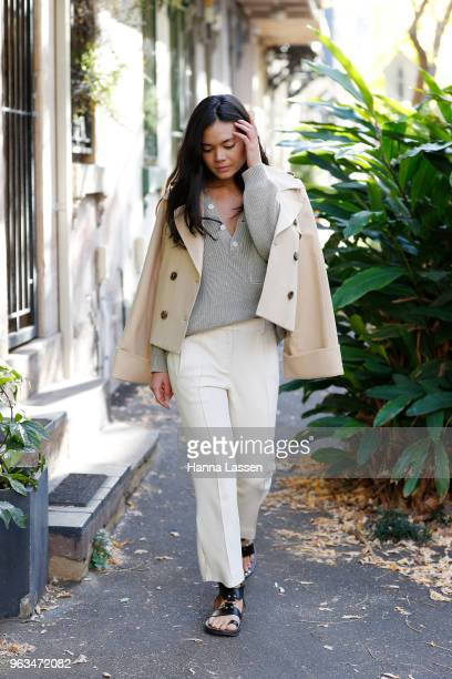 Alex Teo wearing Khaite pants and jacket Shaina Mote sweater and Isabel Marant sandals on May 29 2018 in Sydney Australia