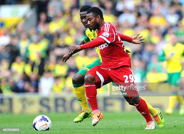 Alex Tettey of Norwich City and Stephane Sessegnon of West Bromwich Albion chase the ball during the Barclays Premier League match between Norwich...