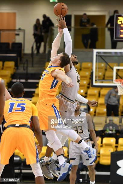 Alex Thomas of the Towson Tigers and Rokas Gustys of the Hofstra Pride tip off the game during a college basketball game at SECU Arena on January 11...