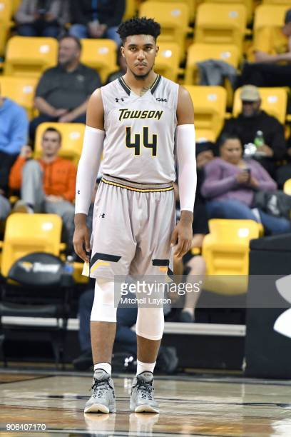 Alex Thomas of the Towson Tigers looks on during a college basketball game against the Hofstra Pride at SECU Arena on January 11 2018 in Towson...