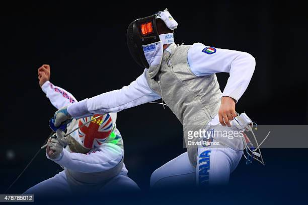 Alex Tofalides of Great Britain and Francesco Ingargiola of Italy compete in the Men's Team Foil Final during day fifteen of the Baku 2015 European...