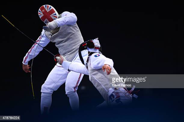 Alex Tofalides of Great Britain and Lorenzo Nista of Italy compete in the Men's Team Foil Final during day fifteen of the Baku 2015 European Games at...