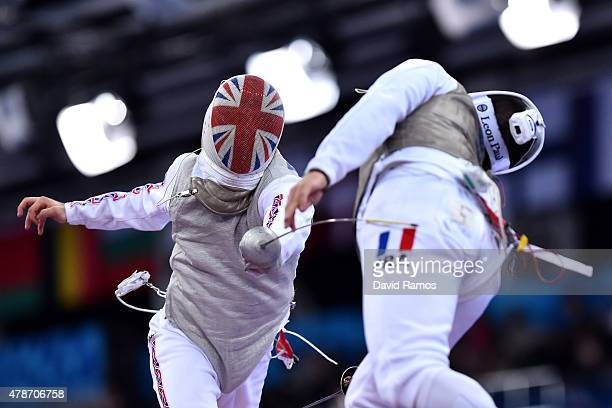 Alex Tofalides of Great Britian and Maxime Pauty of France compete in the Men's Team Foil semi finals during day fifteen of the Baku 2015 European...