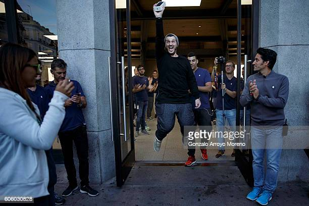 Alex Torodache one of the first customers in purchasing an Iphone 7 jumps celebrating his new acquisition at Puerta del Sol Apple Store the day the...