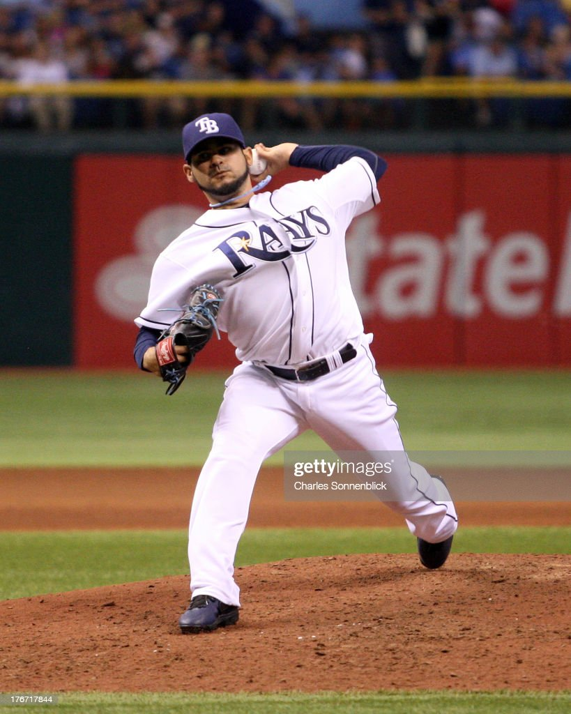 Alex Torres #54 of the Tampa Bay Rays throws a pitch in the sixth inning in relief against the Toronto Blue Jays during the game on August 17, 2013 at Tropicana Field in St. Petersburg, Florida.
