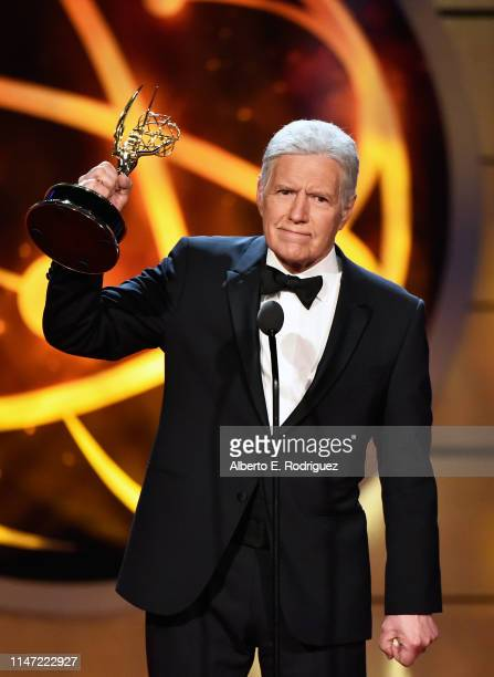 Alex Trebek accepts the Daytime Emmy Award for Outstanding Game Show Host onstage during the 46th annual Daytime Emmy Awards at Pasadena Civic Center...