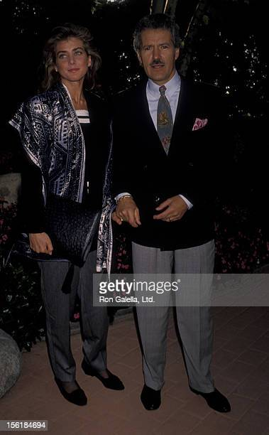 Alex Trebek and wife Jean Currivan attend Hollywood Stars Night Thoroughbred Horse Race on June 22 1990 at Hollywood Park in Hollywood California