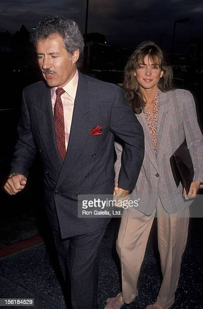 Alex Trebek and wife Jean Currivan attend the opening of 'Jackie Mason Brand New' on May 30 1990 at the Henry Fonda Theater in Hollywood California