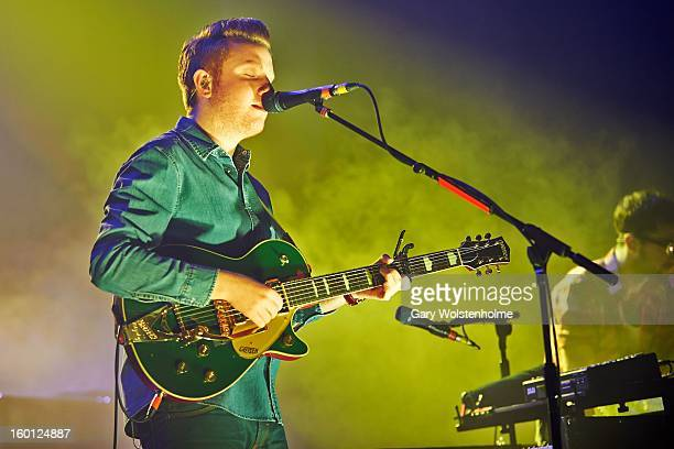 Alex Trimble of Two Door Cinema Club performs on stage at Manchester Apollo on January 26 2013 in Manchester England