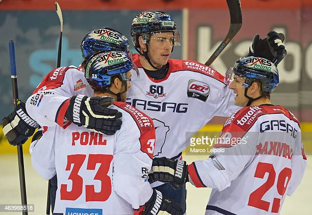 Alex Trivellato, Petr Pohl and Jens Baxmann of the Eisbaeren Berlin celebrate after scoring the 0:3 during the game between Schwenninger Wild Wings...