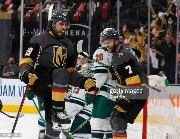 Alex Tuch and Alex Pietrangelo of the Vegas Golden Knights celebrate after Pietrangelo assisted Tuch on a second-period goal against the Minnesota...
