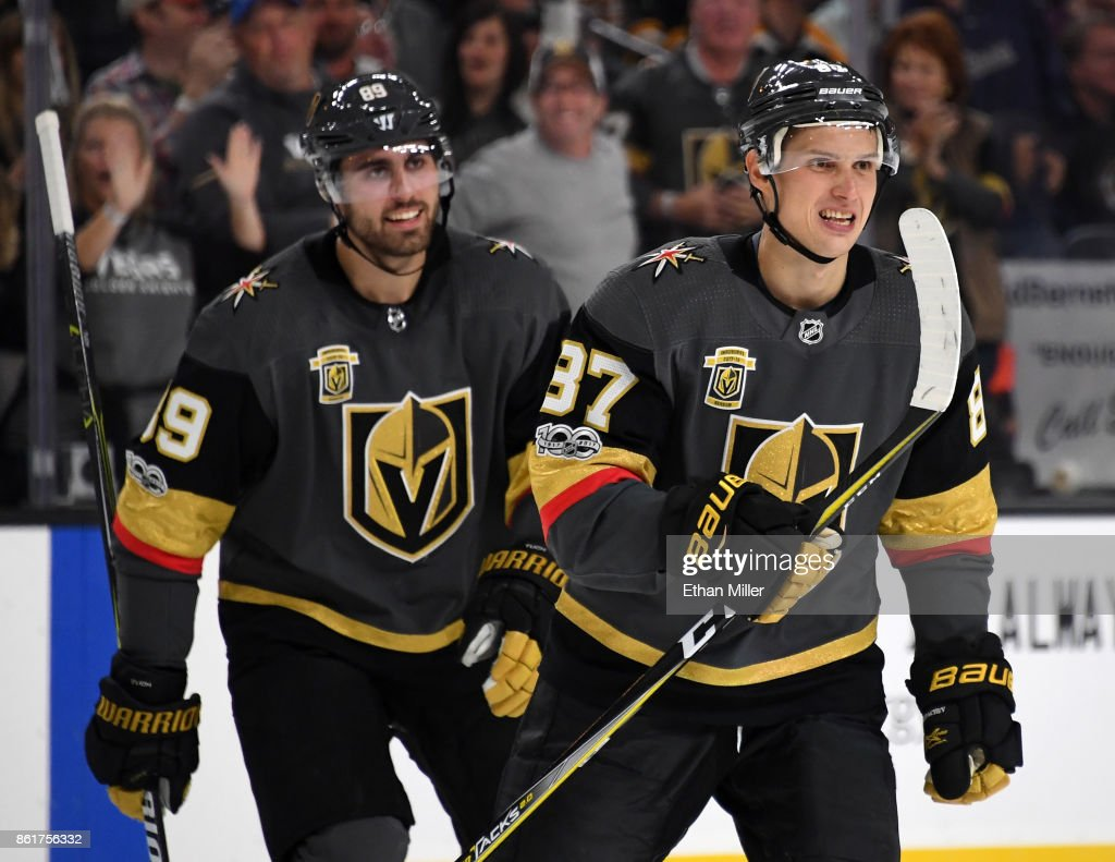 Alex Tuch #89 and Vadim Shipachyov #87 of the Vegas Golden Knights celebrate after Tuch assisted Shipachyov on a second-period goal against the Boston Bruins during their game at T-Mobile Arena on October 15, 2017 in Las Vegas, Nevada.
