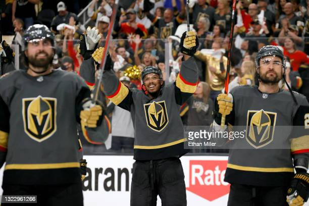 Alex Tuch, Keegan Kolesar and William Carrier of the Vegas Golden Knights celebrate after the team's 6-3 victory over the Colorado Avalanche to win...