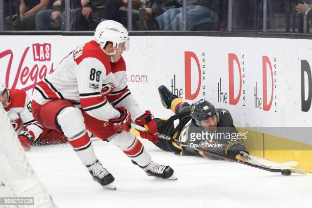 Alex Tuch of the Vegas Golden Knights and Teuvo Teravainen of the Carolina Hurricanes battle for the puck during the game at TMobile Arena on...