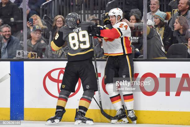 Alex Tuch of the Vegas Golden Knights and Travis Hamonic of the Calgary Flames shove each other during the game at TMobile Arena on February 21 2018...