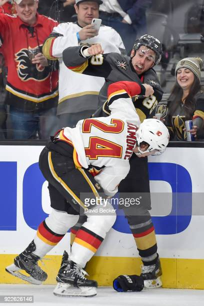 Alex Tuch of the Vegas Golden Knights and Travis Hamonic of the Calgary Flames fight during the game at TMobile Arena on February 21 2018 in Las...