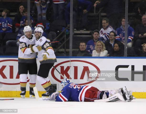 Alex Tuch of the Vegas Golden Knights celebrates his game winning goal at 211 of overtime against Henrik Lundqvist of the New York Rangers as he is...
