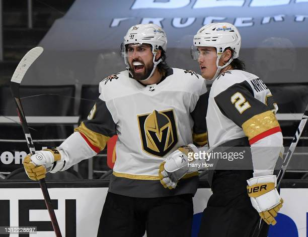 Alex Tuch of the Vegas Golden Knights celebrates his goal with Zach Whitecloud, to take a3-2 lead over the Los Angeles Kings, during the third period...