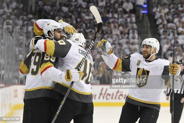Alex Tuch of the Vegas Golden Knights celebrates with teammates after scoring a goal during the first period against the Winnipeg Jets in Game Five...