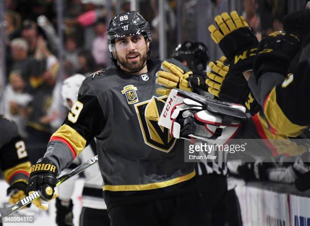 Alex Tuch of the Vegas Golden Knights celebrates with teammates on the bench after he scored a powerplay goal against the Los Angeles Kings in the...