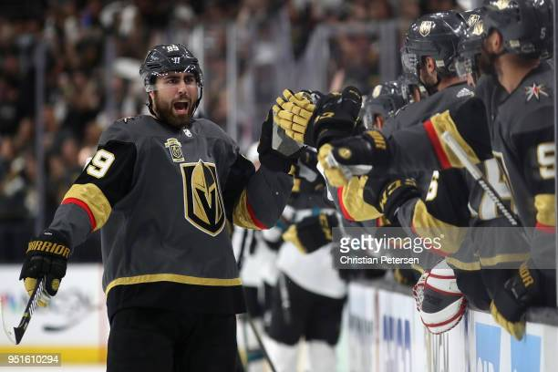 Alex Tuch of the Vegas Golden Knights celebrates with teammates on the bench after scoring a power-play goal against the San Jose Sharks in the first...