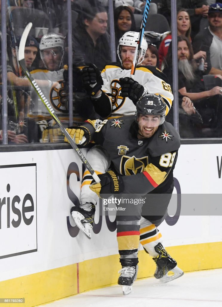 Alex Tuch #89 of the Vegas Golden Knights checks Kevan Miller #86 of the Boston Bruins behind the net in the second period of their game at T-Mobile Arena on October 15, 2017 in Las Vegas, Nevada. The Golden Knights won 3-1.